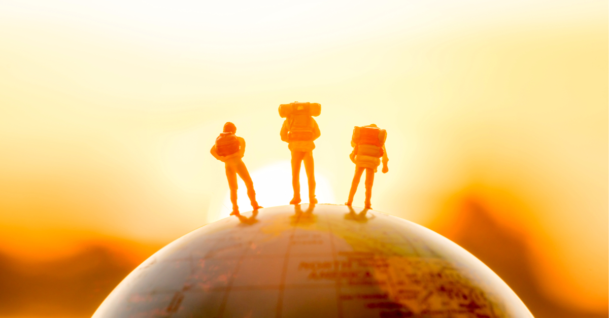 miniature figure people backpack standing on globe with sunset or sunrise sky background - Image